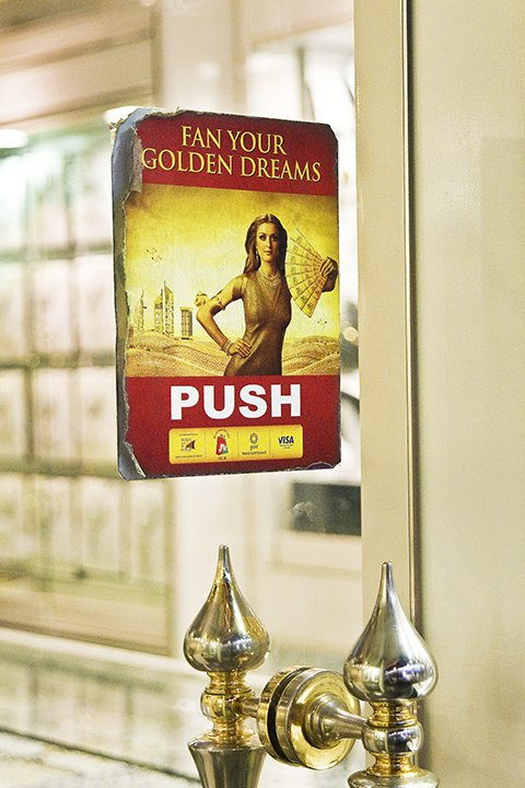 Sign on the front door of a gold store or souk in Dubaii thumbnail