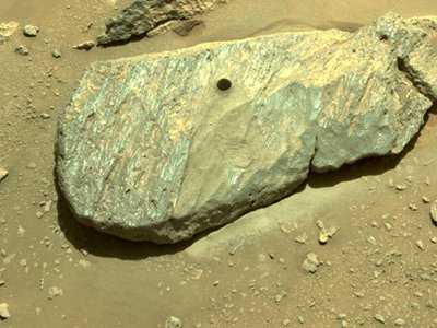 Perseverance drilled into a briefcase-sized Martian boulder named Rochette. The rock is located in the Citadelle location within the Jezero Crater.