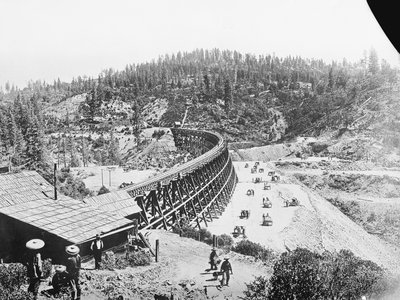 Chinese laborers at work with pick and shovel wheelbarrows and one horse dump carts filling in under the long secret town trestle which was originally built in 1865 on the Present Souther Pacific Railroad lines of Sacramento.