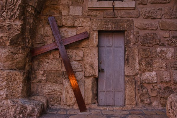 A shaft of light on a cross in the courtyard of the Church of the Holy Sepulcher thumbnail