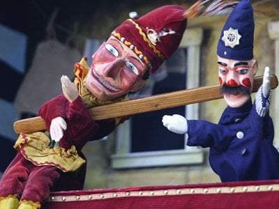A traditional Punch and Judy puppet show.