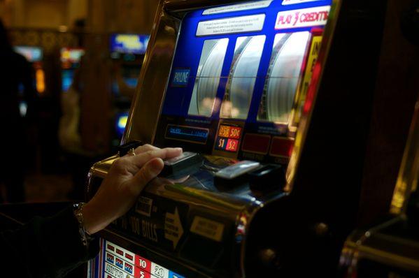 A woman gambles in a casino at Atlantic City. thumbnail