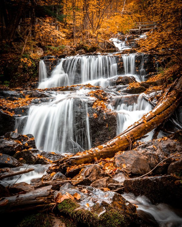 A waterfall captured in autumn while hiking through Quebec thumbnail