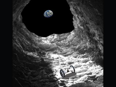 An artist's concept of the Axel rover rappelling into a lunar pit.