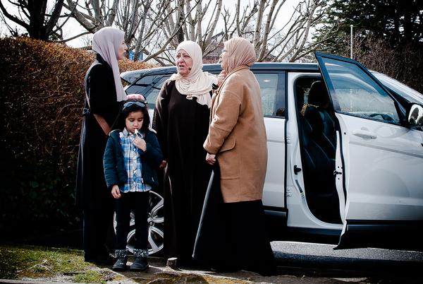 A group of Muslim women speak after Friday prayer. thumbnail