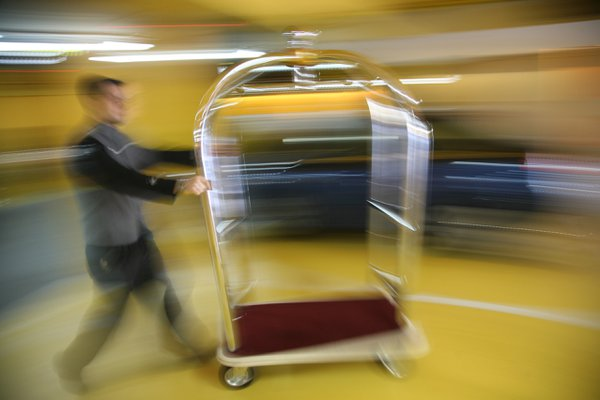 Bellhop moving fast at the Hotel Puerta de America in Madrid, Spain. thumbnail