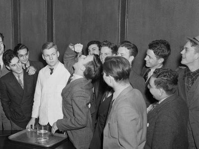 On March 3, 1939, Harvard freshman Lothrop Withington, Jr., swallows a, live, squirming goldfish to win a ten dollar bet. He reportedly practiced the feat for days before by swallowing baby goldfish and tadpoles.