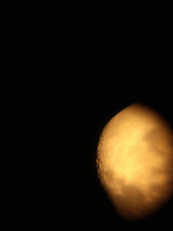 The golden gibbous waning moon with craters. thumbnail