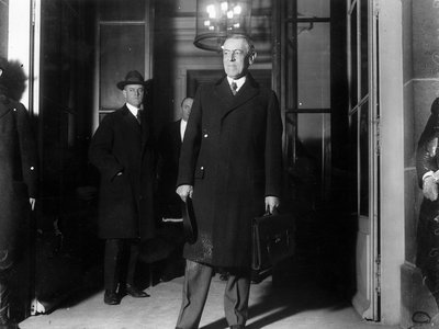 Woodrow Wilson, seen here at the start of the Paris Peace Conference in January 1919, never publicly acknowledged the pandemic's toll on his country.