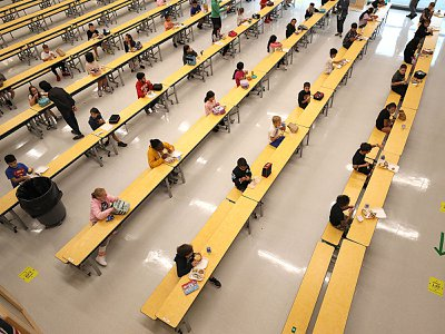 School children are spaced apart in one of the rooms used for lunch at Woodland Elementary School in Milford, Massachusetts on Sept. 11, 2020.