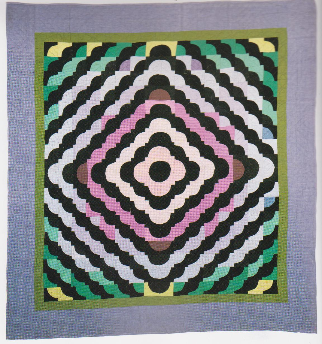 Colorful handmade quilt with a diamond pattern