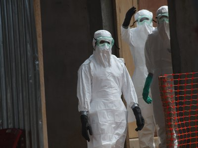 Nurses in a Liberian hospital dressed in protective clothing to prevent the spread of Ebola