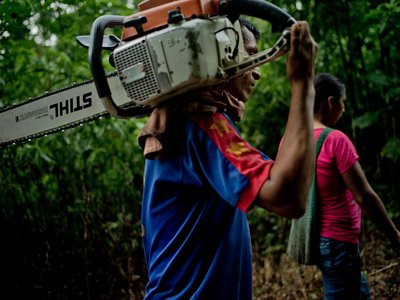 A Kiwcha couple walk into the forest to cut timber in Coca, Ecuador.