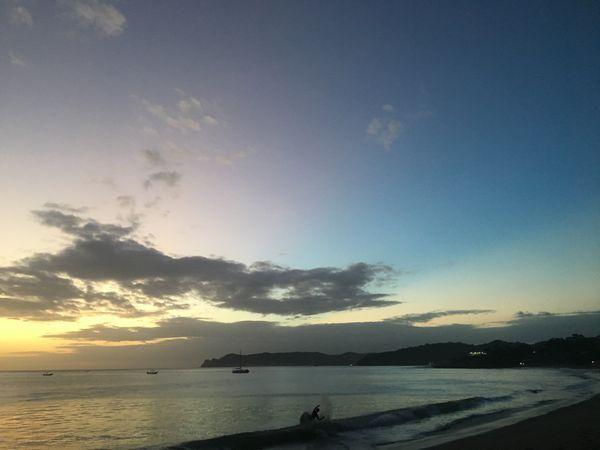 Riding the wave under an indecisive, Nicaraguan sky thumbnail