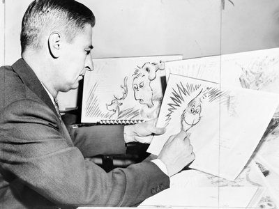 Dr. Seuss works on an early drawing of the Grinch.