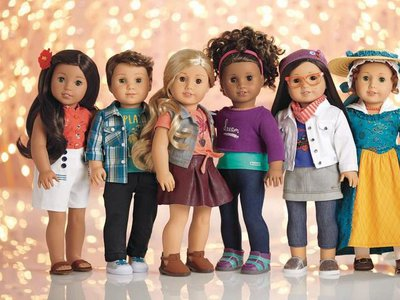 Logan (second from right) is the first ever boy American Girl doll.
