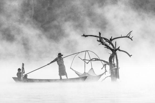 Fishermen at the foggy morning thumbnail