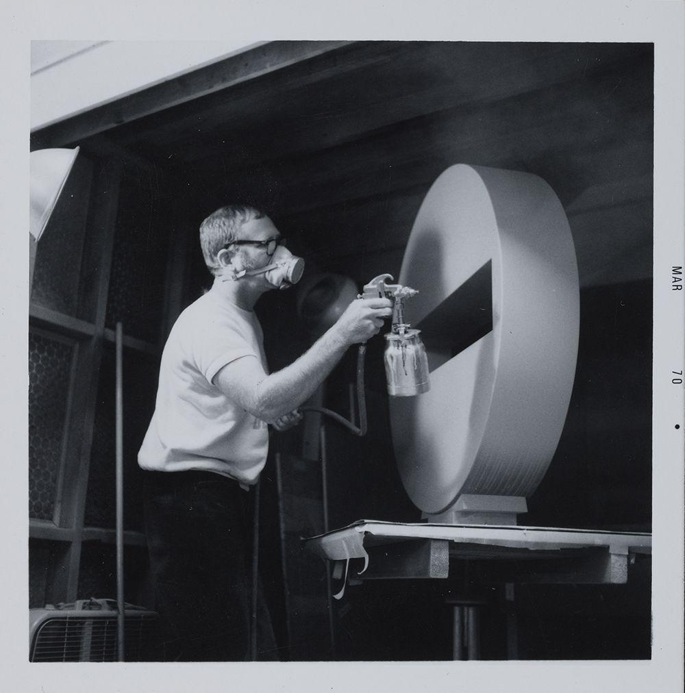 Photograph of artist Tony DeLap working in his studio