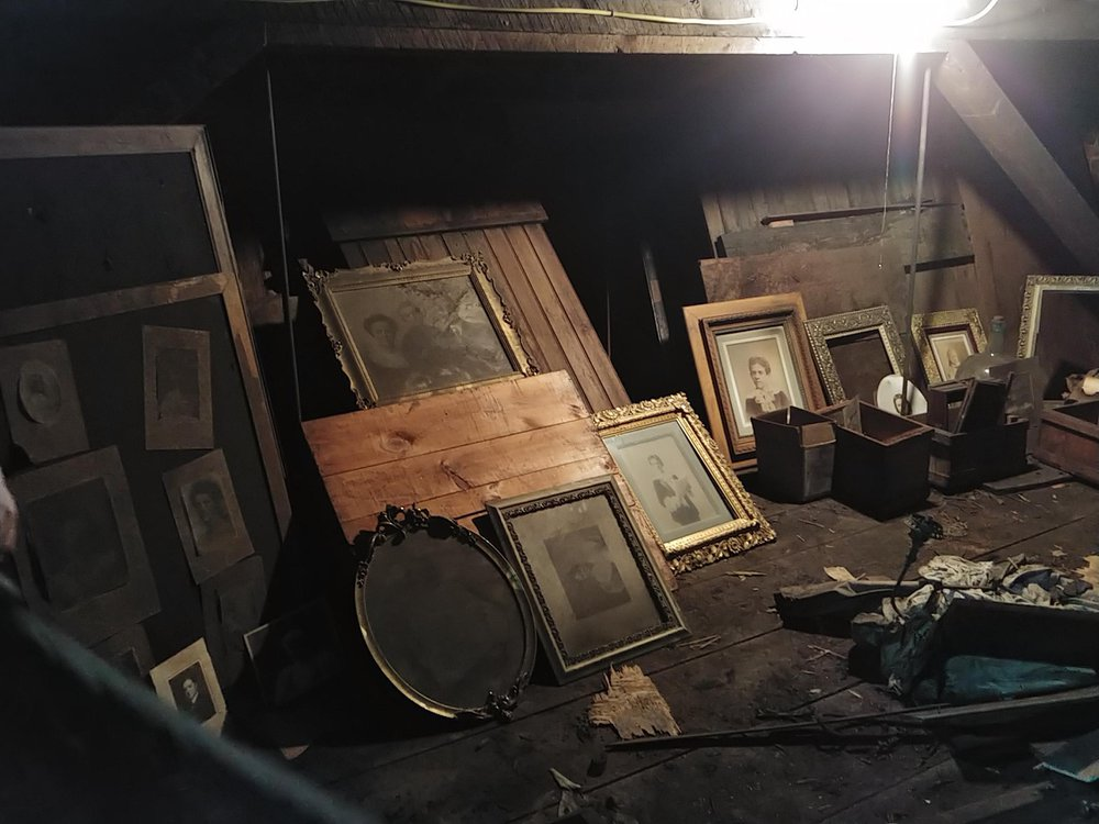 Frames and photographs found in the secret attic studio