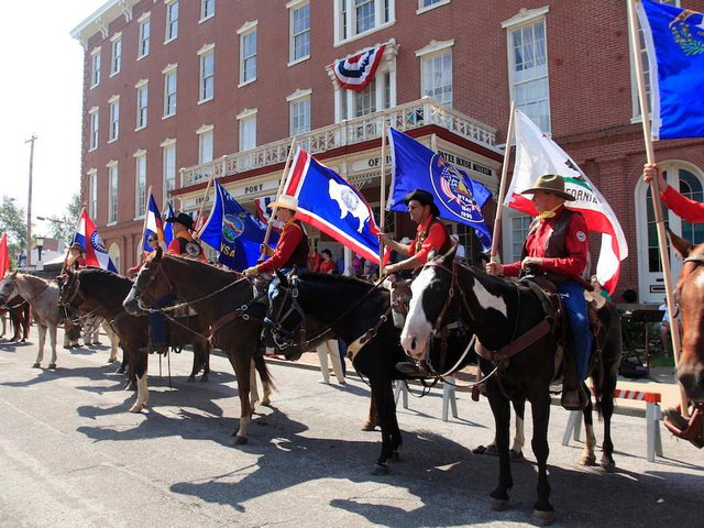 Riders outside the Patee House Museum in St. Joseph, Missouri, the route's eastern terminus. Every year the National Pony Express Association conducts an annual re-ride of the famous delivery route.