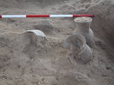 Beer-drinking cups being excavated at Khani Masi held some of the earliest chemical evidence of beer. Researchers had to take extra precautions to avoid contaminating the cups with modern compounds.