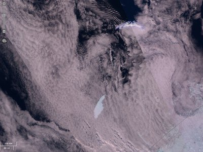 A satellite image shows the A68a iceberg in the lower left. The chunk of ice looks a bit like a pointed finger, and scientists say it's currently on a path to collide with the British Overseas Territory of South Georgia.