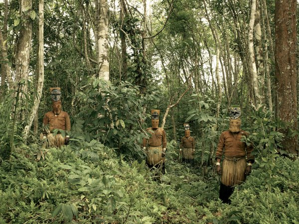 Guardians of the Forest - Yucuna indians, deep in the Colombian Amazon, dressed in their traditional suits for the Baile del Mueco, or Puppet Dance, in which they celebrate the abundance of the chonta thumbnail
