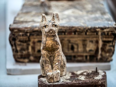 A cat statue is displayed after the announcement of a new discovery carried out by an Egyptian archaeological team in Giza's Saqqara necropolis.