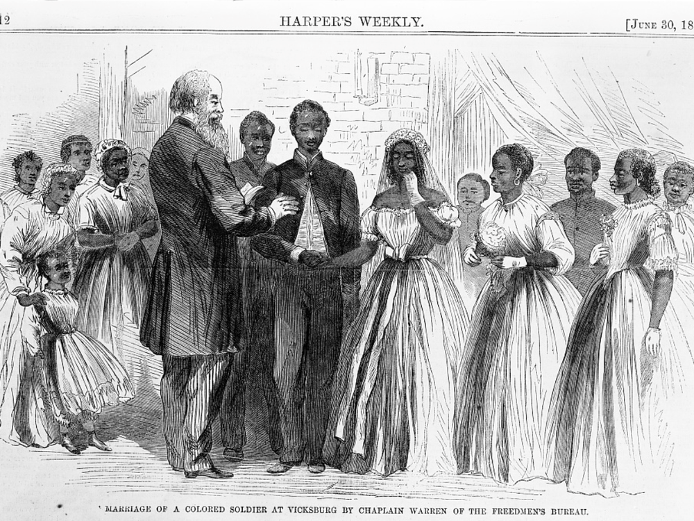 A black and white engraving of a wedding scene in a courtroom