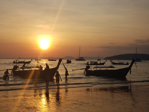 Long boats at sunset thumbnail