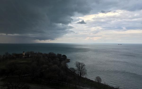 Symmetric storm clouds and shoreline at Lake Michigan thumbnail