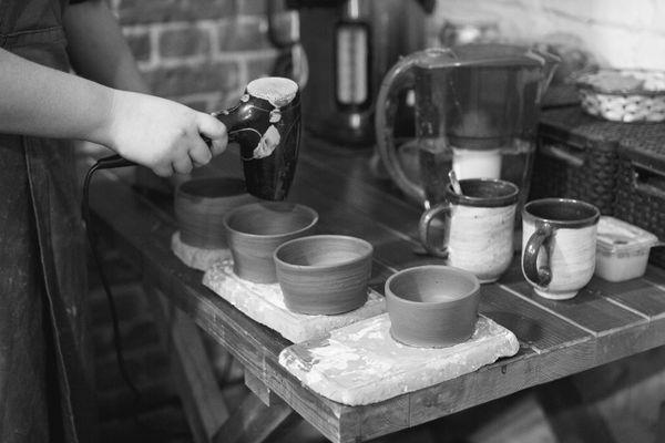 Drying clay pots thumbnail