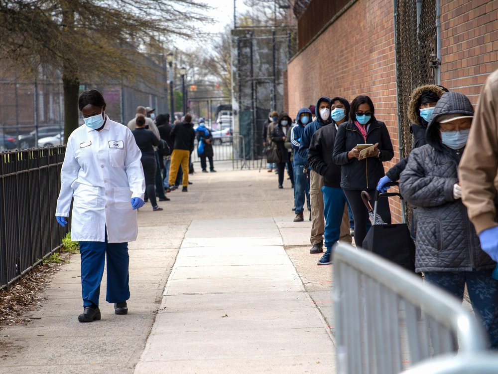 a line, mostly of people of color, waiting for COVID-19 tests in Brooklyn