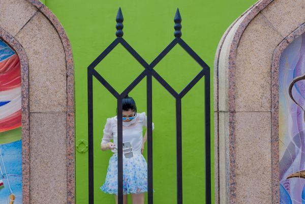 Asian woman with green wall thumbnail