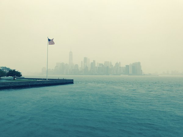 New York in the fog looking on from Ellis Island thumbnail