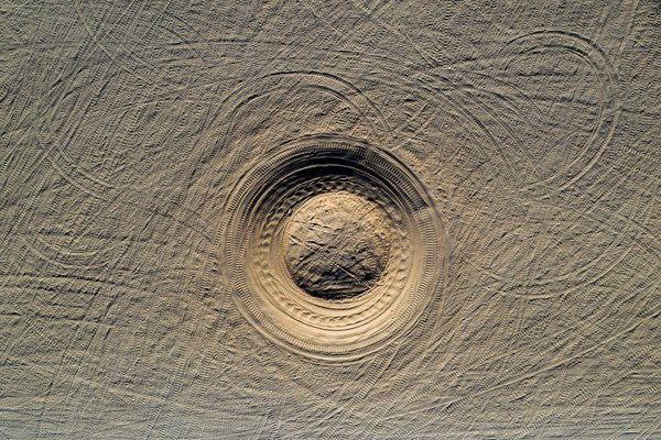 An abstract aerial view of a circular swale at Glamis sand dunes, CA. thumbnail