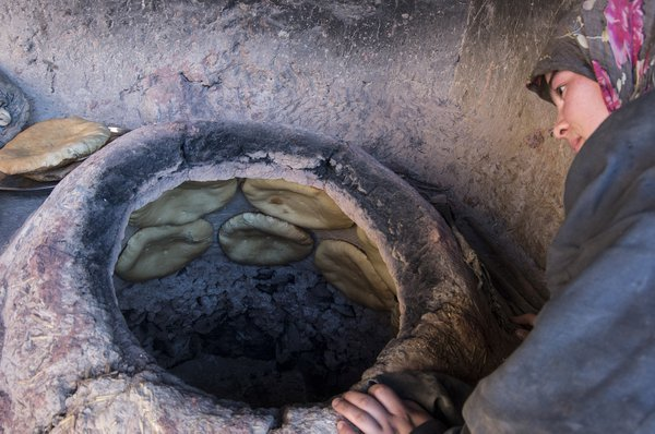 Making bread in tandir, a traditional clay oven thumbnail