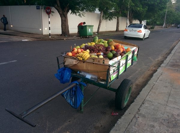 Behind a carriage full of fruit... thumbnail