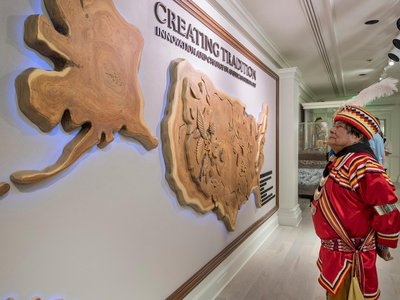 """Seminole Indian medicine man and rainmaker, Bobby Henry, visits the Walt Disney World Resort gallery exhibition """"Creating Tradition: Innovation and Change in American Indian Art"""" in The American Adventure pavilion at Epcot."""
