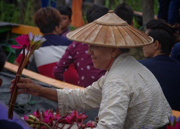 A woman selling lotus by boat at Inlae Lake. thumbnail