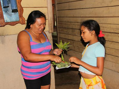 """The show honors the """"living legacy"""" of Native peoples (above: Idalis Ramírez Rojas and her daughter Ingrid of eastern Cuba) in the Spanish-speaking Caribbean and on the U.S. mainland."""