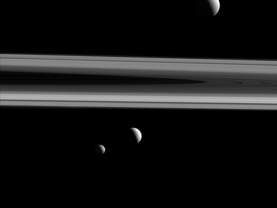 NASA's Cassini spacecraft captures three of Saturn's moons—Tethys, Enceladus and Mimas—in this group photo.