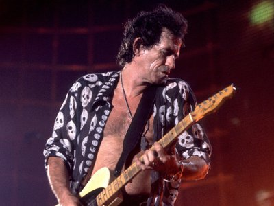 British musician Keith Richards of the Rolling Stones performs on stage during the band's 'Voodoo Lounge' tour, late 1994.