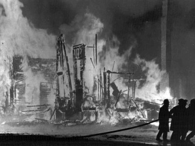 Firemen fight to control blazing buildings in Detroit on July 25, 1967. The city was filled with gunfire, looting and police officers for five days that July.