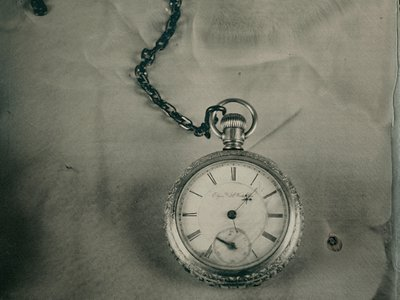 Pocket watch with engraved, gold-plated case found on the body of postal clerk John Starr March. The hands point to 1:27, around when the Titanic sank on the morning of April 15, 1912.