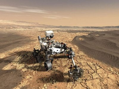 Artist's conception of the Perseverance rover sampling rocks on the floor of Jezero crater. The rover also carries the Ingenuity helicopter (not shown) that can fly in advance of the rover and scout out high priority rocks and outcrops for the rover to visit. (NASA)