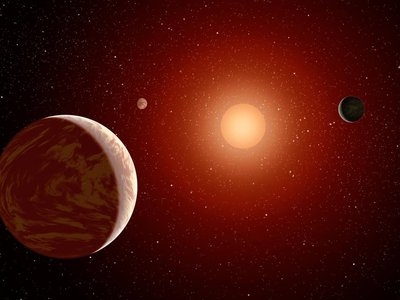 This artist's conception shows a dim red dwarf surrounded by three planets. To hold life at their surface, red dwarf planets must orbit close to their star, putting them in the line of fire from dangerous flares.