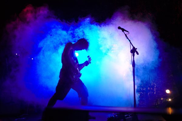 Bassist against light and smoke thumbnail