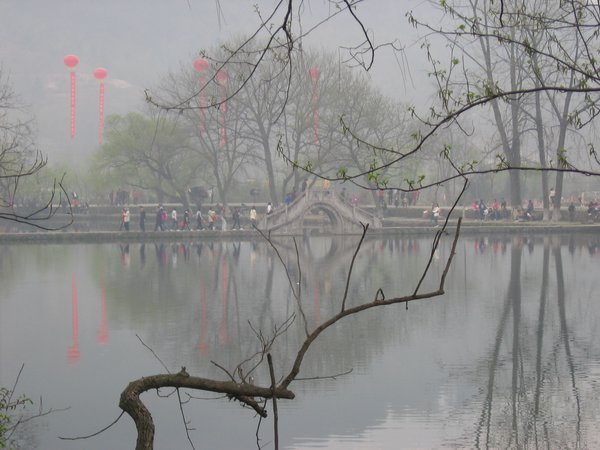 Willows and banners hang around an ancient Chinese village thumbnail