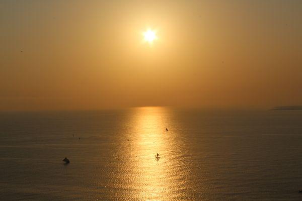 Sunset at the bay of Cabo Haitiano. Rep. Haiti thumbnail